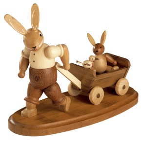Easter bunny, male, with child on wooden handcart
