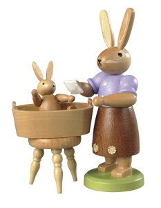 Easter bunny, female, with little child have a bath