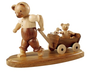 Bear, male, with child on wooden handcart