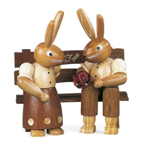 Easter bunny, couple, on garden bench