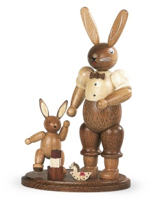 Easter bunny, male, with playing child